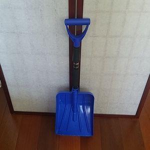 Blue and black adjustable snow shovel